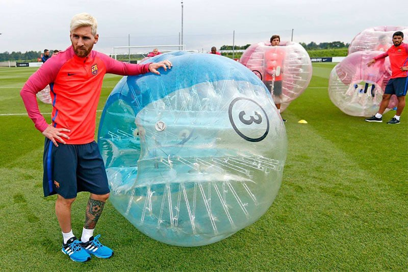 Messi and Barcelona Team playing zorb soccer